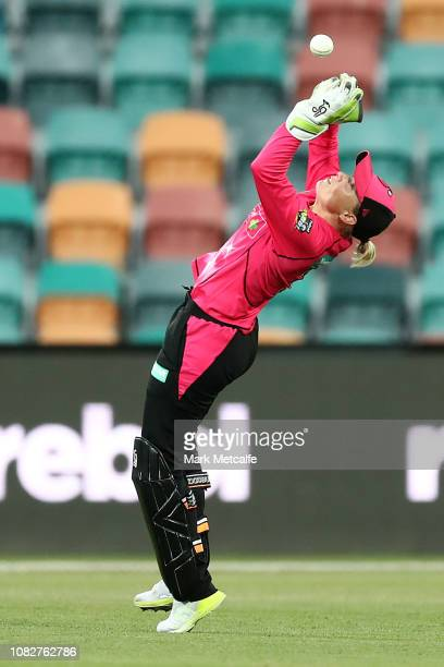 Alyssa Healy of the Sixers takes a catch to dismiss Smriti Mandhana of the Hurricanes during the Women's Big Bash League match between the Hobart...