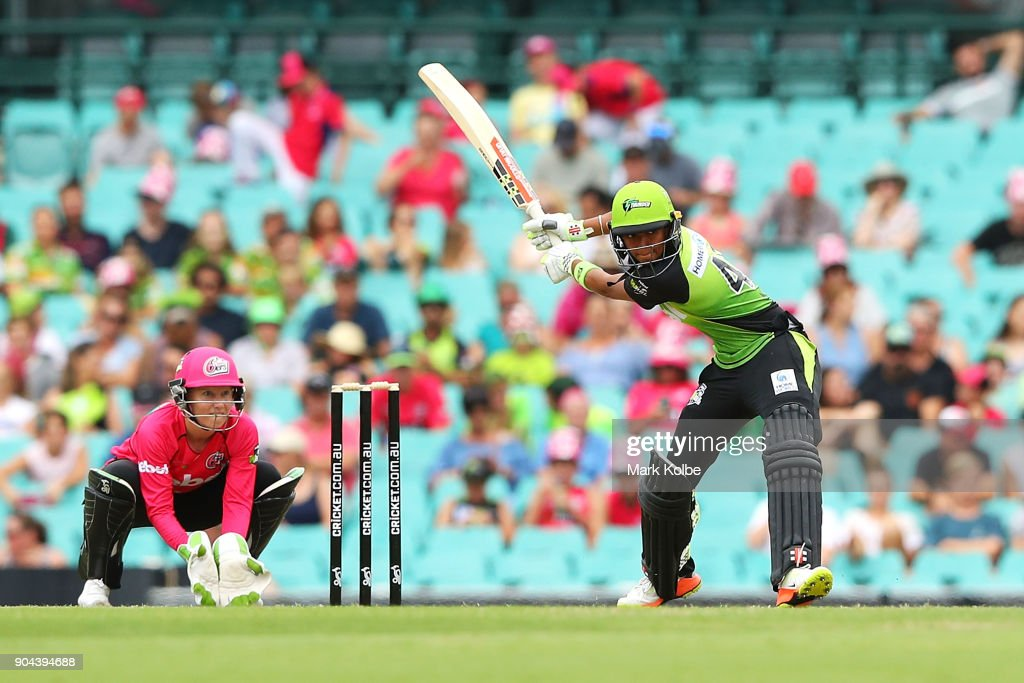 Alyssa Healy of the Sixers watches on as Harmanpreet Kaur of the Thunder bats during the Women's Big Bash League match between the Sydney Sixers and the Sydney Thunder at Sydney Cricket Ground on January 13, 2018 in Sydney, Australia.