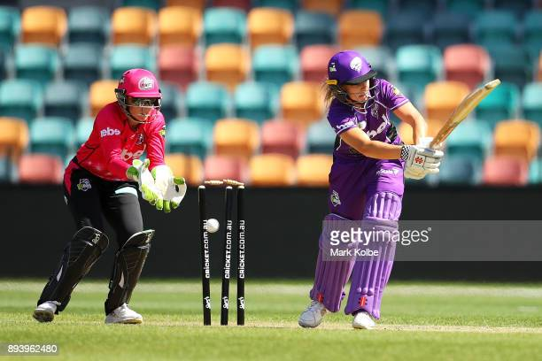 Alyssa Healy of the Sixers watches on as Lauren Winfield of the Hurricanes is bolwed by Sarah Aley of the Sixers during the Women's Big Bash League...