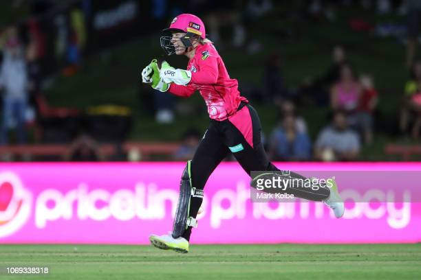 Alyssa Healy of the Sydney Sixers runs out Chloe Piparo of the Scorchers during the Women's Big Bash League match between the Sydney Sixers and the...