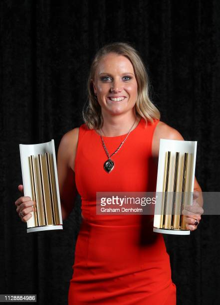 Alyssa Healy poses with the Belinda Clark award the Women's T20 Player of the Year award and the Women's ODI Player of the Year award during the 2019...