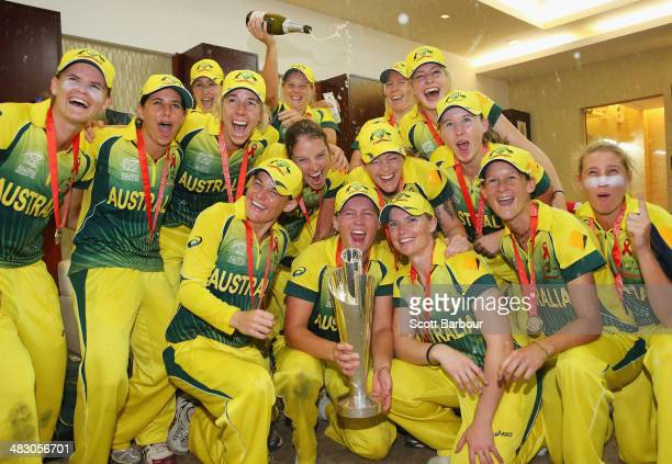 Alyssa Healy sprays champagne as the Australian celebrate with the trophy in the changing rooms after winning the Final of the ICC Women's World...