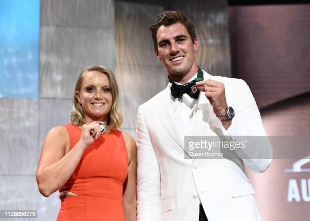 Alyssa Healy winner of the Belinda Clark Award and Pat Cummins the winner of the Allan Border Medal pose during the 2019 Australian Cricket Awards at...