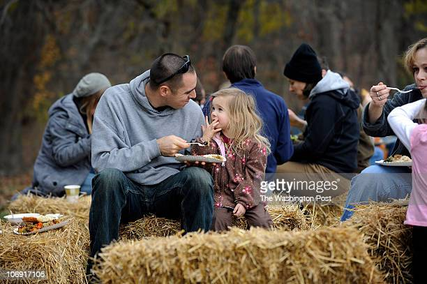 Alyssa Kiffer 4 years old and her father Harold attend a Vegan Thanksgiving potluck at Poplar Springs Animal Sanctuary where turkeys are fed a feast...