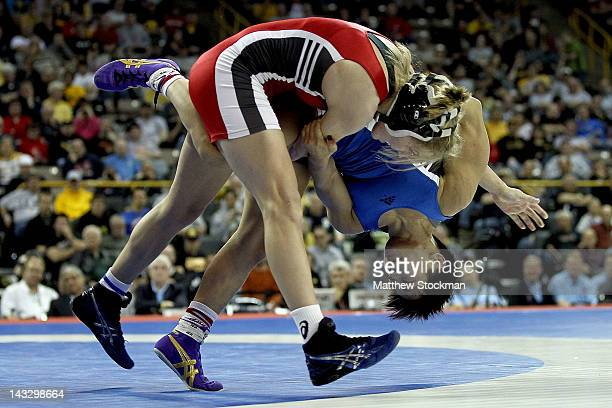 Alyssa Lampe wrestles Clarissa Chun in the 48 kg freestyle weight class during the finals of the US Wrestling Olympic Trials at Carver Hawkeye Arena...