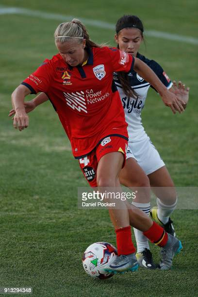 Alyssa Mautz of Adelaide United and Angela Beard of Melbourne Victory contest the ball during the round 14 WLeague match between Adelaide United and...