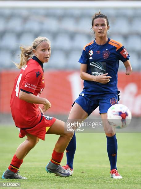 Alyssa Mautz of Adelaide United and Carson Pickett of Brisbane Roar during the round 13 WLeague match between Adelaide United and the Brisbane Roar...