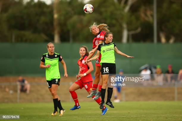 Alyssa Mautz of Adelaide United and Karly Rosetbakken of Canberra United FC compete for the ball during the round 10 WLeague match between Canberra...