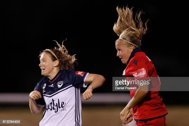 Alyssa Mautz of Adelaide United heads the ball under pressure from Kristen McNabb of Melbourne Victory during the round 14 WLeague match between...