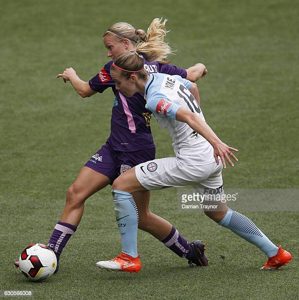 Alyssa Mautz of Perth Glory and Beverly Goebel of Melbourne City compete during the round eight WLeague match between Melbourne City and Perth at...