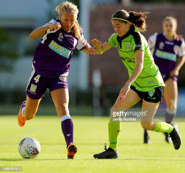 Alyssa Mautz of the Perth Glory and Karly Roestbakken of Canberra United contest for the ball during the round 10 WLeague match between the Perth...