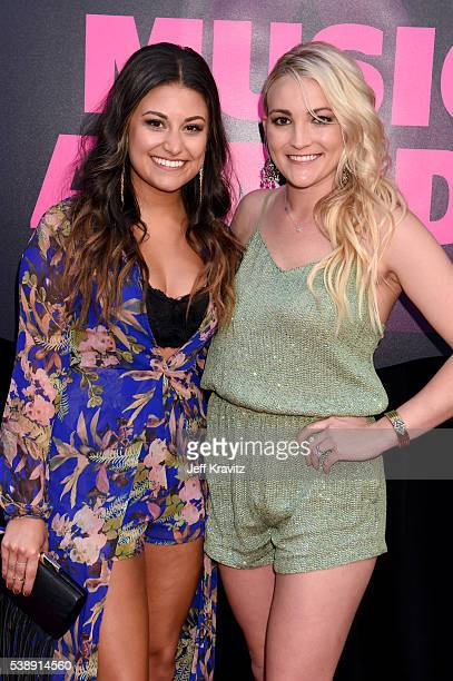 Alyssa Micaela and Jamie Lynn Spears attend the 2016 CMT Music awards at the Bridgestone Arena on June 8 2016 in Nashville Tennessee