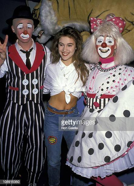 Alyssa Milano and Clowns during Ringling Brothers Circus August 2 1989 at LA Sports Arena in Los Angeles California United States