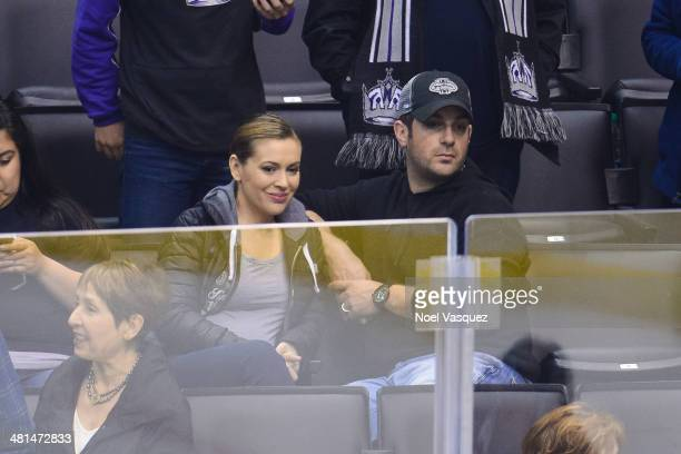 Alyssa Milano and Dave Bugliari attend a hockey game between the Winnipeg Jets and the Los Angeles Kings at Staples Center on March 29 2014 in Los...