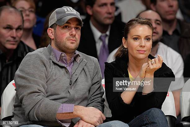 Alyssa Milano and David Bugliari attend a game between the Philadelphia 76ers and the Los Angeles Lakers at Staples Center on February 26 2010 in Los...