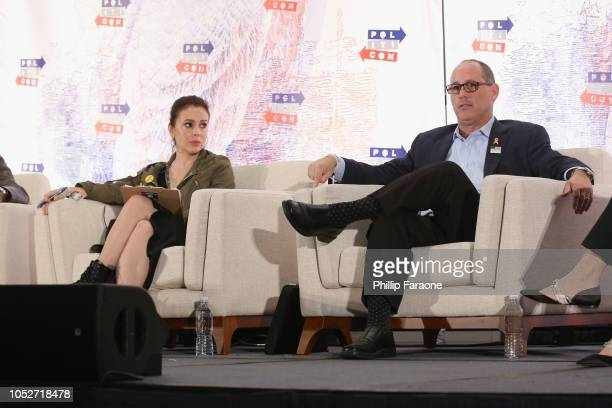 Alyssa Milano and Fred Guttenberg speak onstage during Politicon 2018 at Los Angeles Convention Center on October 21 2018 in Los Angeles California