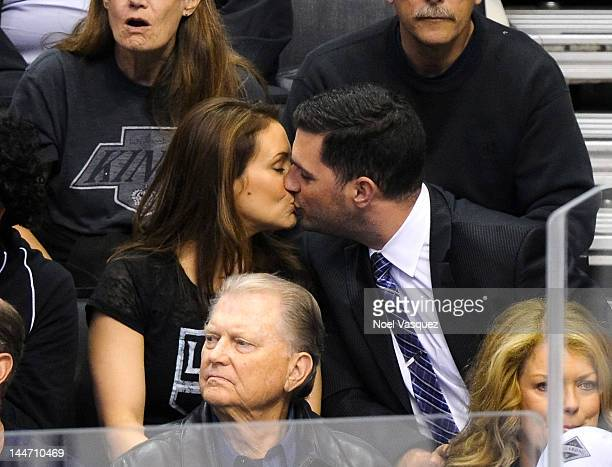 Alyssa Milano and her husband David Bugliari kiss at the Los Angeles Kings vs Phoenix Coyotes playoff hockey game at Staples Center on May 17 2012 in...