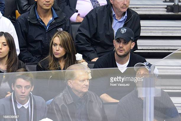 Alyssa Milano and husband David Bugliari attend an NHL playoff game between the St Louis Blues and the Los Angeles Kings at Staples Center on May 10...