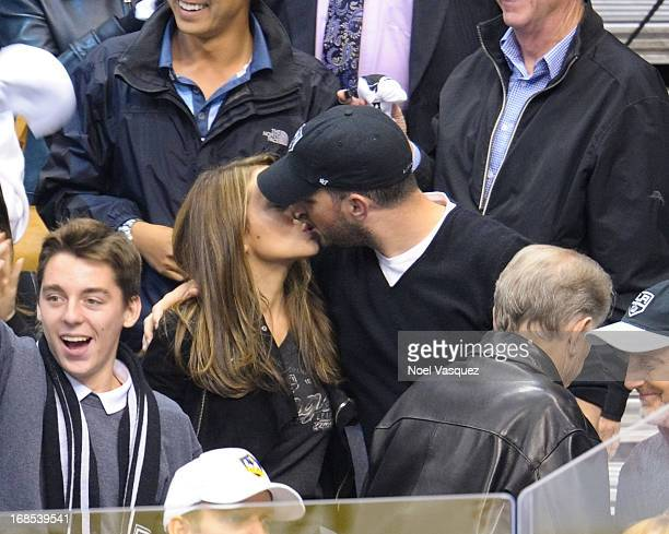 Alyssa Milano and husband David Bugliari kiss at the conclusion of an NHL playoff game between the St Louis Blues and the Los Angeles Kings at...
