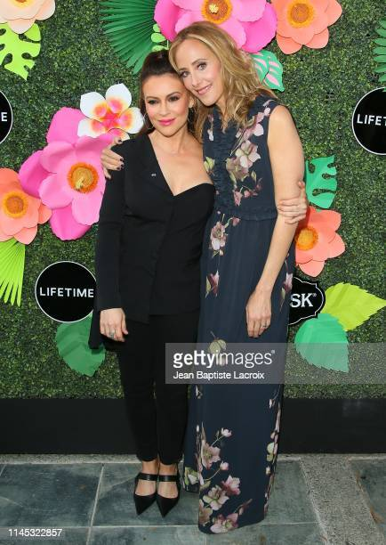 Alyssa Milano and Kim Raver attend the Lifetime's Summer Luau at W Los Angeles Westwood on May 20 2019 in Los Angeles California