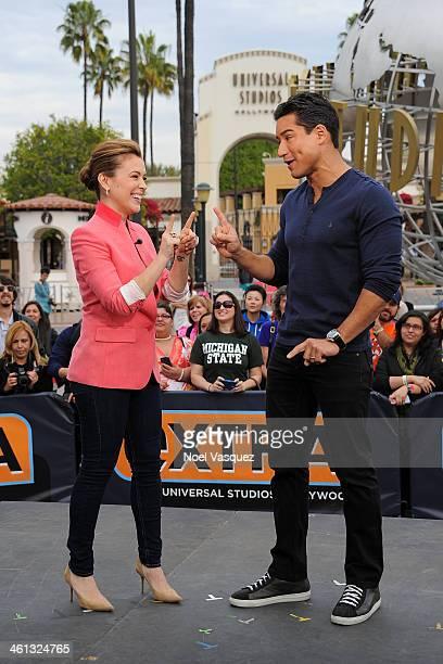 Alyssa Milano and Mario Lopez visit 'Extra' at Universal Studios Hollywood on January 7 2014 in Universal City California
