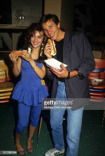 Alyssa Milano and Rob Stone having hot dogs from the television movie 'Crash Course' 1988