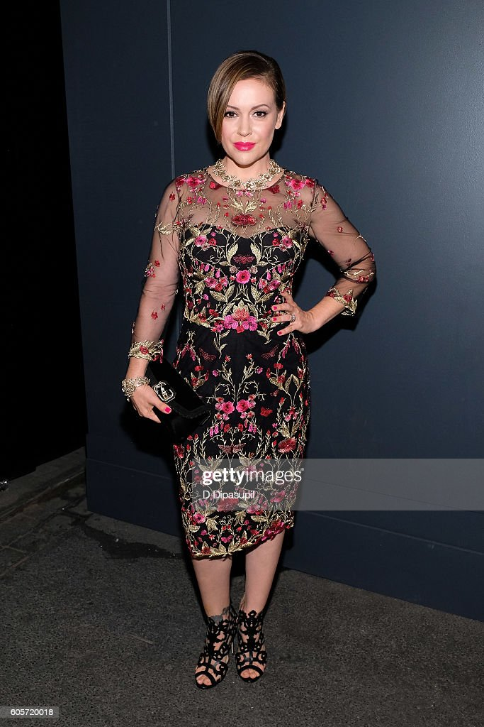 Alyssa Milano poses during New York Fashion Week: The Shows at Skylight at Moynihan Station on September 14, 2016 in New York City.