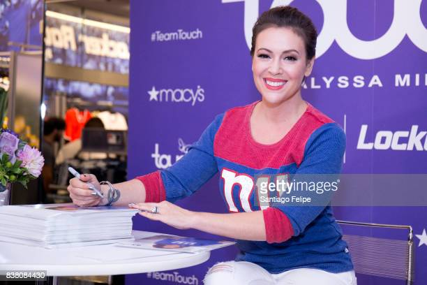 Alyssa Milano poses for photos during 'Touch By Alyssa Milano' Launch at Macy's Herald Square on August 23 2017 in New York City