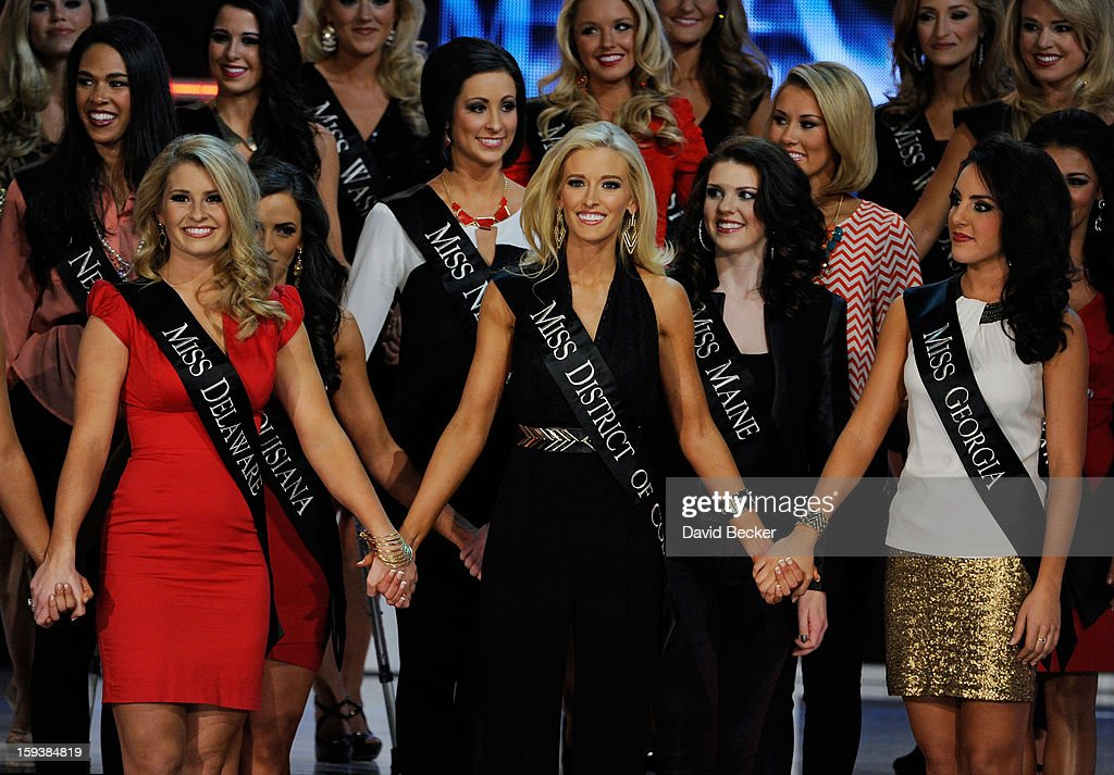 Alyssa Murray, Miss Delaware, Allyn Rose, Miss District of Columbia and Leighton Jordan, Miss Georgia hold hands during the 2013 Miss America Pageant at PH Live at Planet Hollywood Resort & Casino on January 12, 2013 in Las Vegas, Nevada.