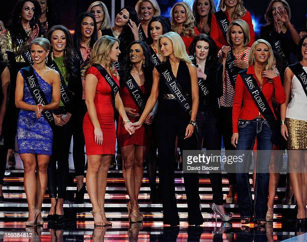 Alyssa Murray Miss Delaware and Allyn Rose Miss District of Columbia hold hands during the 2013 Miss America Pageant at PH Live at Planet Hollywood...