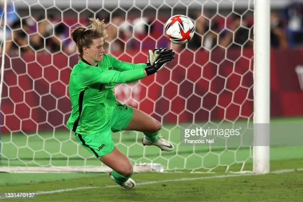 Alyssa Naeher of Team United States saves the fourth penalty from Aniek Nouwen of Team Netherlands during the Women's Quarter Final match between...