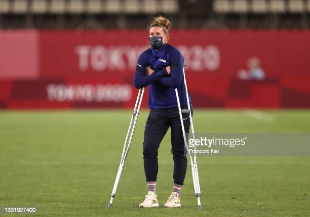 Alyssa Naeher of Team United States stands with crutches following her injury as she looks dejected following defeat in the Women's Semi-Final match...