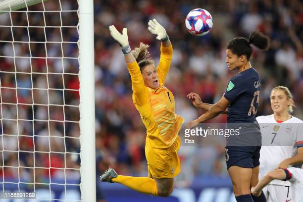 Alyssa Naeher of the USA battles for possession with Valerie Gauvin of France during the 2019 FIFA Women's World Cup France Quarter Final match...