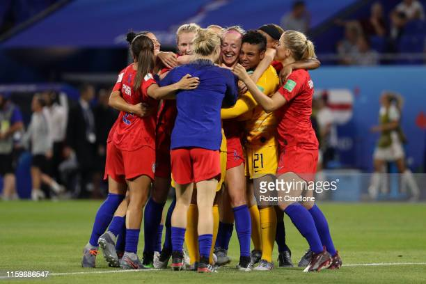 Alyssa Naeher of the USA celebrates victory with her team mates as they mob her after the 2019 FIFA Women's World Cup France Semi Final match between...