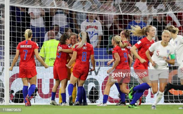 Alyssa Naeher of the USA celebrates with her teammates after saving a penalty during the 2019 FIFA Women's World Cup France Semi Final match between...