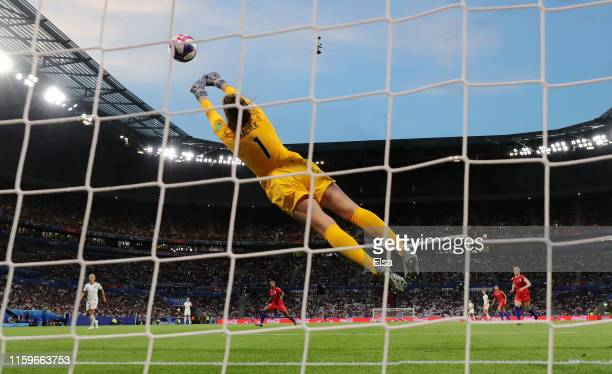 Alyssa Naeher of the USA makes a save during the 2019 FIFA Women's World Cup France Semi Final match between England and USA at Stade de Lyon on July...