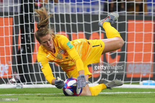 Alyssa Naeher of the USA saves a penalty during the 2019 FIFA Women's World Cup France Semi Final match between England and USA at Stade de Lyon on...