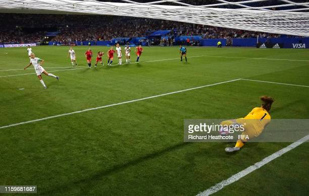 Alyssa Naeher of the USA saves a penalty from Steph Houghton of England during the 2019 FIFA Women's World Cup France Semi Final match between...