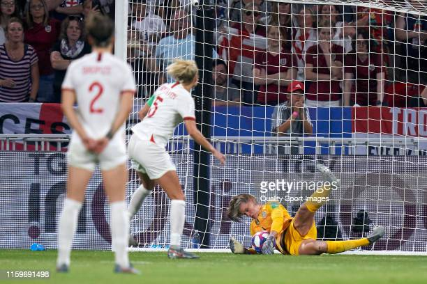 Alyssa Naeher of USA stops the penalty kick during the 2019 FIFA Women's World Cup France Semi Final match between England and USA at Stade de Lyon...