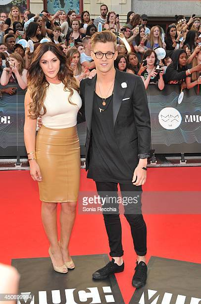 Alyssa Reid and Virginia To Vegas arrive at the 2014 MuchMusic Video Awards at MuchMusic HQ on June 15 2014 in Toronto Canada