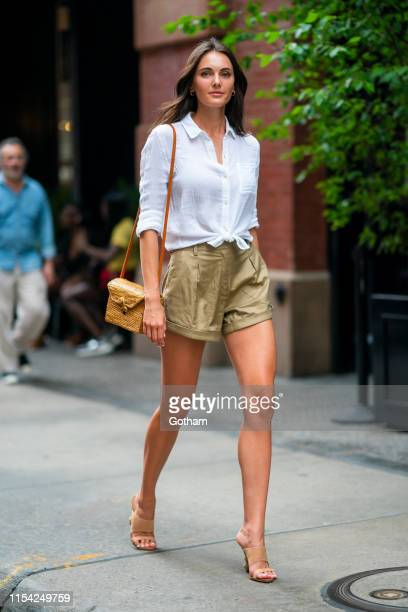 Alyssa Riley is seen wearing a Rails shirt Revolve shorts with Schutz shoes in SoHo on June 06 2019 in New York City
