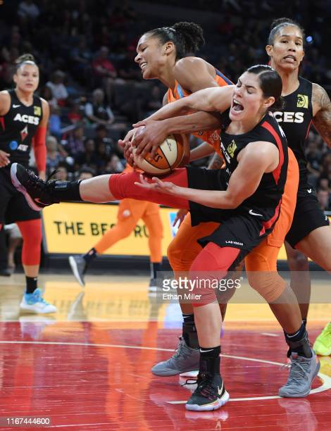Alyssa Thomas of the Connecticut Sun and Kelsey Plum of the Las Vegas Aces fight for a rebound during their game at the Mandalay Bay Events Center on...