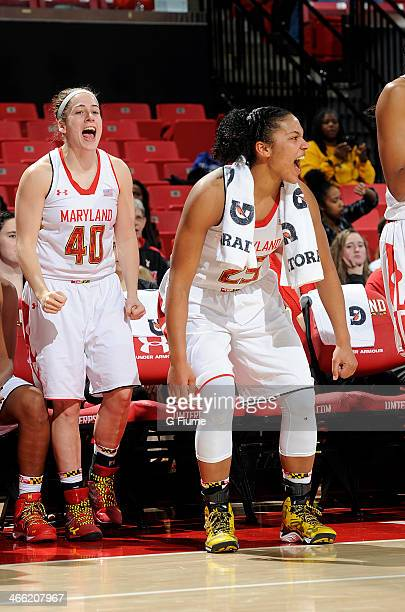 Alyssa Thomas and Katie Rutan of the Maryland Terrapins celebrate during the game against the Delaware State Hornets at the Comcast Center on...
