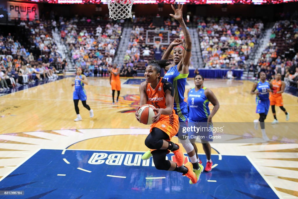 Alyssa Thomas #25 of the Connecticut Sun drives to the basket defended by Glory Johnson #25 of the Dallas Wings during the Connecticut Sun Vs Dallas Wings, WNBA regular season game at Mohegan Sun Arena on August 12th, 2017 in Uncasville, Connecticut.