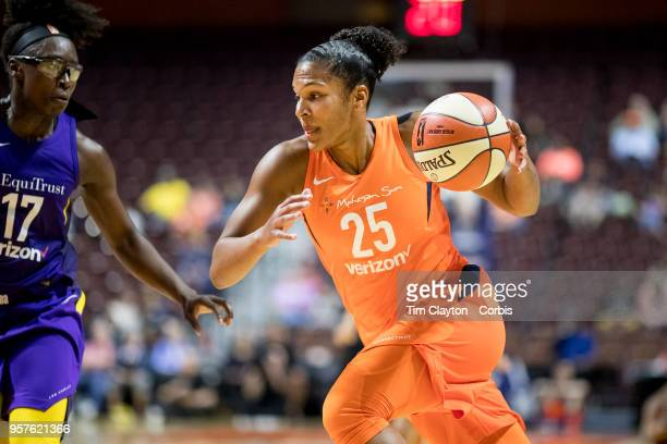 Alyssa Thomas of the Connecticut Sun drives to the basket defended by Essence Carson of the Los Angeles Sparks during the Connecticut Sun Vs Los...