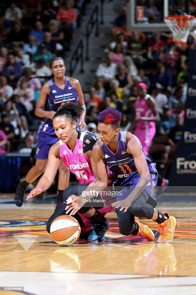 Alyssa Thomas #25 of the Connecticut Sun goes for a loose ball against Danielle Robinson #11 of the Phoenix Mercury on August 20, 2017 at Mohegan Sun Arena in Uncasville, CT.