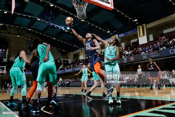 Alyssa Thomas of the Connecticut Sun goes to the basket against the New York Liberty on June 7 2018 at Westchester County Center in White Plains New...