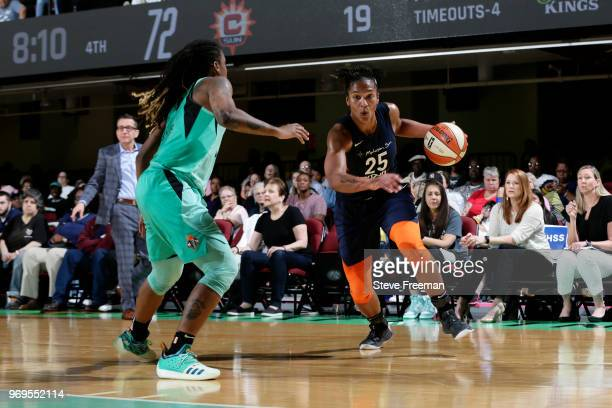 Alyssa Thomas of the Connecticut Sun handles the ball against the New York Liberty on June 7 2018 at Westchester County Center in White Plains New...