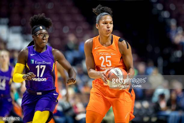 Alyssa Thomas of the Connecticut Sun in action defended by Essence Carson of the Los Angeles Sparks during the Connecticut Sun Vs Los Angeles Sparks...