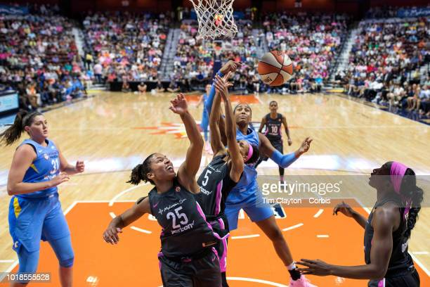 Alyssa Thomas of the Connecticut Sun Jasmine Thomas of the Connecticut Sun and Alaina Coates of the Chicago Sky challenge for a rebound during the...